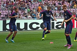 Munir El Haddadi - Rafinha, Gerard Piqué and Munir (right) warming up for Barcelona in August 2014 before the fixture against Napoli.
