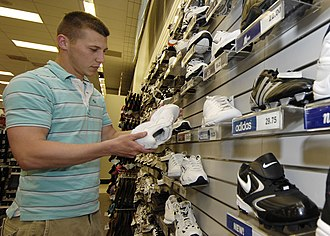 Base Exchange - A U.S. Army soldier shops for shoes at the Base Exchange (BX) at Scott Air Force Base in May 2008.