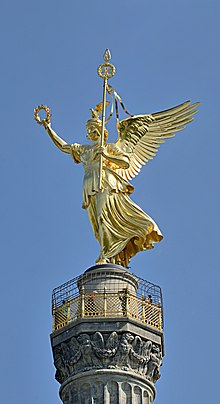 http://upload.wikimedia.org/wikipedia/commons/thumb/7/7e/Berlin_-_Siegess%C3%A4ule_Spitze.jpg/220px-Berlin_-_Siegess%C3%A4ule_Spitze.jpg