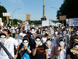Reactions to global surveillance disclosures - Demonstration of the Pirate Party of Germany against PRISM in Berlin, Germany, 2013.