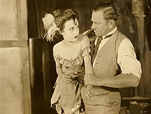 Bessie Love and Wallace Beery in scene from Dynamite Smith (1924).jpg