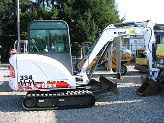 Compact excavator - A Bobcat mini excavator. Note the backfill blade