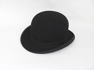 Bowler hat hard, round-crowned hat with a narrow rolled brim