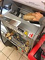 Bread slicing machine Foodtech Brødskjæremaskin EXTRA COOP Norway 2017-11-02 loaf of brad into machine.jpg