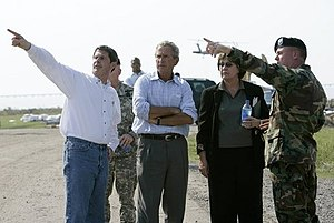 Kathleen Blanco - President George W. Bush tours damage in the Township of Metairie where Hurricane Katrina broke through the levee with, from left, Louisiana Senator David Vitter, Governor Kathleen Blanco and Army Corps of Engineers Col. Richard Wagenaar Friday, Sept. 2, 2005. White House photo by Eric Draper