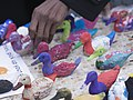CARE International - Display of 196 papier-maché ducks painted on by 300 French children (23217168440).jpg