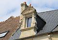 Caen 136 rue Caponière lucarne datée 1634.JPG