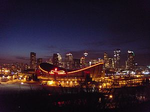 Scotiabank Saddledome - The Saddledome and Calgary skyline at night