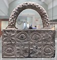 Carved stone with integral handle BM 91700.jpg