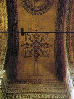 Ceiling decoration showing original Christian cross still visible through the later aniconic decoration Ceiling decorations in Hagia Sofia.jpg