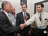 Charles Bolden congratulates Eric Finnegan as the spacecraft successfully inserted itself in Mercury's orbit.