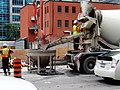 Cement truck, and bucket, at the excavation SE of Victoria and Richmond, 2017 08 18 -b (35893442403).jpg