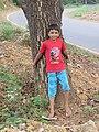 Child hugging tree at Peravoor (8).jpg
