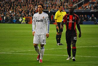 Clarence Seedorf - Seedorf playing against former club Real Madrid. On the left is Mesut Özil.
