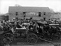 Co-operative Wholesale Society. Poultry Depot exterior showing people and covered carts. Ballygawley (42299853474).jpg