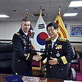 Col. Michael. E. Masley, commander of U.S. Army Garrison Yongsan and Kwon Sun-Kyung, fire marshal of Seoul Fire and Disaster Headquarters, shake hands after signing their mutual aid agreement.jpg