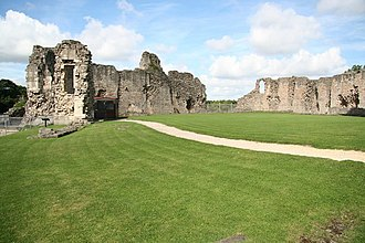 Conisbrough Castle - The inner bailey seen from the east, showing the former locations of the gatehouse and the solar block (left), and the castle's hall (right)