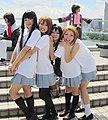 Cosplayers of Mio Akiyama, Yui Hirasawa, Azusa Nakano, and Ritsu Tainaka at Comic Market 82 20120821.jpg