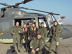 Crew and SAR swimmers in front of a Lynx from the MLD refuel on Rotterdam Den Hague airport.jpg