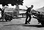 Crewmen with HVAR rockets on USS Forrestal (CVA-59) c1958.jpg