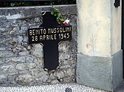 Cross marking the place in Mezzegra where Mussolini was shot