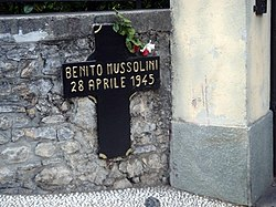 Memorial cross into Mussolini's death place
