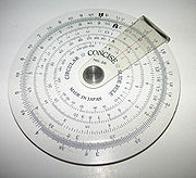 A simple circular slide rule, made by Concise Co., Ltd., Tokyo, Japan, with only inverse, square and cubic scales. On the reverse is a handy list of 38 metric/imperial conversion factors.