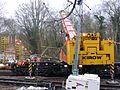 DRK81612 Kirow Rail Crane removes footbridge (32875422281).jpg