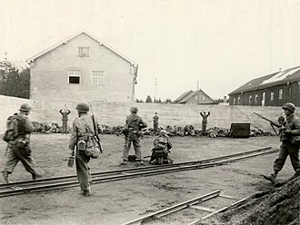 United States war crimes - SS concentration camp guards being executed at Dachau concentration camp on its day of liberation (U.S. Army soldier photograph/National Archives)