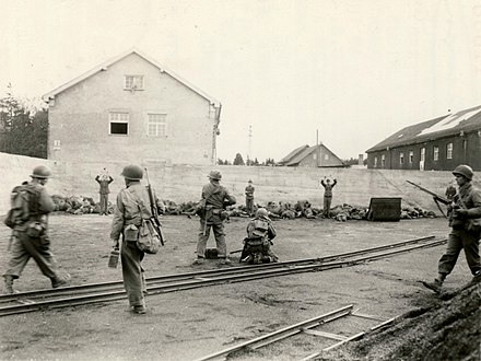 SS concentration camp guards being executed at Dachau concentration camp on its day of liberation (U.S. Army soldier photograph/National Archives) Dachau execution coalyard 1945-04-29.jpg