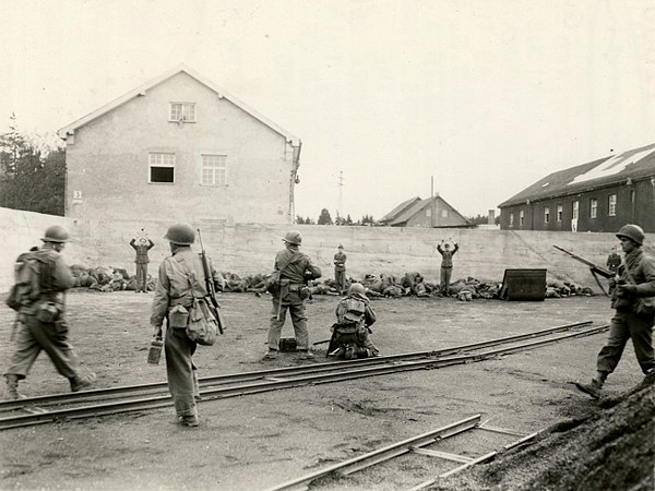 Photo showing execution of Waffen-SS troops in a coal yard in the area of the Dachau concentration camp during its liberation. 29 April 1945 (US Army photograph) Dachau execution coalyard 1945-04-29.jpg