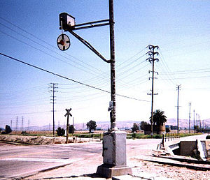 Wigwag (railroad) - This lower-quadrant Magnetic Flagman wigwag signal was retired after more than six decades of service atop its Union Switch & Signal base on Mountain Avenue in Redlands, California. For economy, railroads occasionally installed signals on existing utility poles. This particular unit was replaced with as-yet unused highway flashers and gates as part of the Redlands Passenger Rail Project.