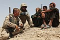 Defense.gov News Photo 100809-M-5648G-026 - U.S. Marine Corps Gunnery Sgt. Nelson Martinez left with Weapons Company 3rd Battalion 7th Marine Regiment and an interpreter speak with Afghan.jpg