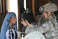 Defense.gov News Photo 100905-A-1182G-066 - U.S. Air Force Airman 1st Class Jennifer Marchese with 455th Expeditionary Security Forces Squadron-Bravo Sector scans an Afghan woman s iris in.jpg