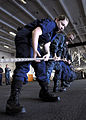 Defense.gov News Photo 110107-N-4590G-068 - Sailors assigned to the aircraft carrier USS Ronald Reagan CVN 76 heave a line to secure a connection with the Military Sealift Command fleet.jpg