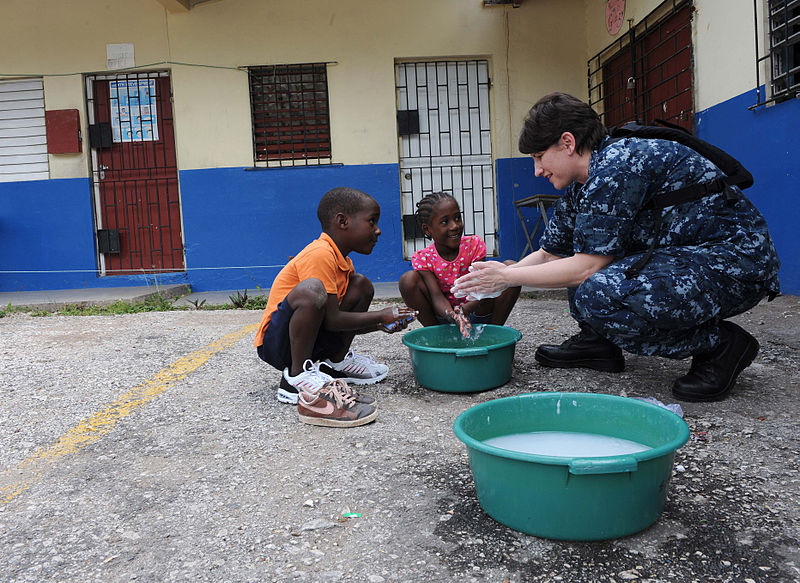 File:Defense.gov News Photo 110421-F-ET173-114 - Lt. Danna Convoy teaches children how to properly wash their hands during a Continuing Promise community service event in Kingston Jamaica on.jpg