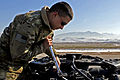 Defense.gov News Photo 120207-A-GT185-816 - U.S. Army Pfc. James Dennis performs a torque check on the main rotor head of a UH-60 Black Hawk helicopter at Camp Marmal Afghanistan on Feb. 7.jpg