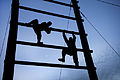 Defense.gov News Photo 120316-A-XN107-604 - Soldiers climb an obstacle during a noncommissioned officer professional development event at Fort Bragg N.C. on March 16 2012. The soldiers.jpg