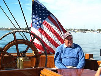 "Dennis Conner - A photo of America's Cup winner Dennis Conner while aboard a replica of the original Cup winner ""America"" in San Diego in 2010"