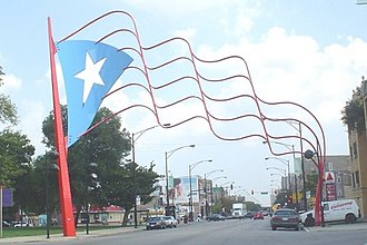Puerto Ricans in the United States - Division Street (Paseo Boricua) in Chicago, facing east from Mozart Street, one-half block west of California Avenue.