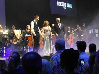 Ben Foster (orchestrator) - Foster, alongside Elin Manahan Thomas and Peter Davison at the Doctor Who Symphonic Spectacular in Leeds, 2015.