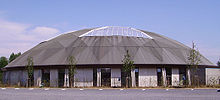 The structure has a round roof with a large skylight.