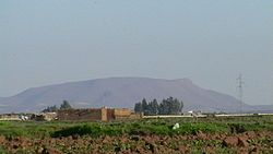 "The ""Green Mountain"", the only visible hill, east of the region"