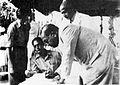 Dr. Ambedkar signing a register.jpg