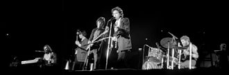 Bob Dylan and the Band 1974 Tour - Bob Dylan, center, with the Band (Garth Hudson not visible) February 2, 1974