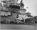 "Dynamic static. The motion of its props causes an ""aura"" to form around this F6F on USS YORKTOWN. Rapid change of... - NARA - 520641.tif"