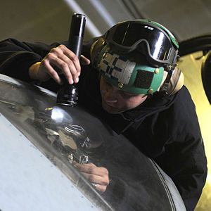Inspection - Maintenance check of electronic equipment on a U.S. Navy aircraft.
