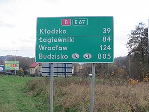 European route E67 - Distance sign behind the Czech border in Poland