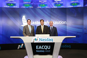 Darrell Crate - Darrell Crate (left of center) ringing the NASDAQ opening bell.