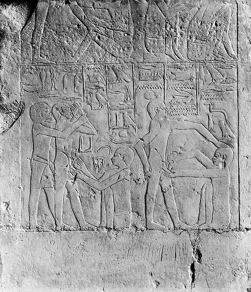 Egypt, wall carving showing a circumcision scene, Sakkara Wellcome M0005235